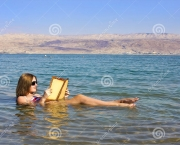 http://www.dreamstime.com/stock-photos-young-girl-reads-book-floating-dead-sea-israel-beautiful-woman-waters-image53317193