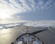 ARCTIC OCEAN -- An optical phenomenon known as a sun dog or halo, which is produced by light interacting with suspended ice crystals in the atmosphere, appears off Coast Guard Cutter Healy's port bow at the North Pole Sept. 5, 2015.   Healy is underway in the Arctic Ocean in support of Geotraces, an international effort to study the distribution of trace elements in the world's oceans. U.S. Coast Guard photo by Petty Officer 2nd Class Cory J. Mendenhall.